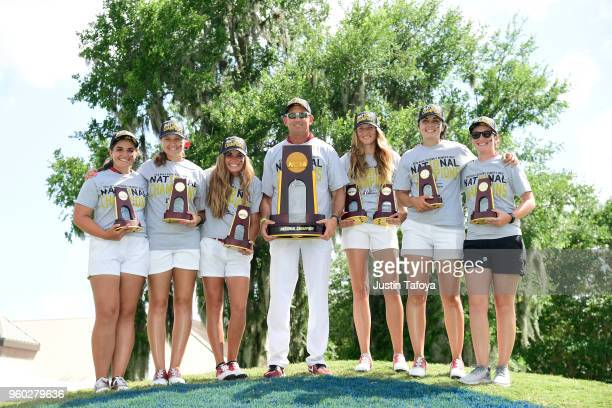 The University of Indianapolis celebrates with the team championship trophy during the Division II Women's Golf Championship held at Bay Oaks Country...