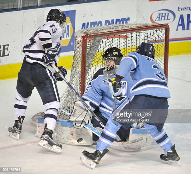 The University of Maine hockey team played the University of New Hampshire at the Cross Insurance Center on Tuesday night Maine goalie Rob McGovern...