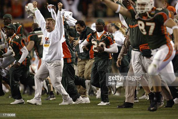 The University of Miami Hurricanes sideline prematurely celebrates an apparent BCS Championship victory over the Ohio State Buckeyes at the end of...
