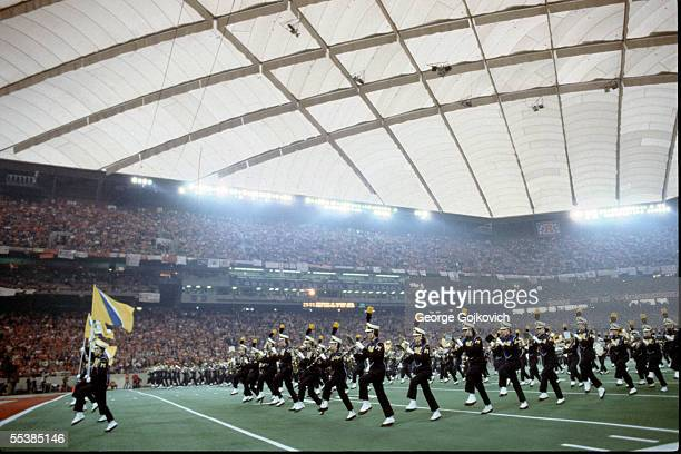 The University of Michigan Marching Band performs at Super Bowl XVI at the Pontiac Silverdome on January 24 1982 in Pontiac Michigan The San...