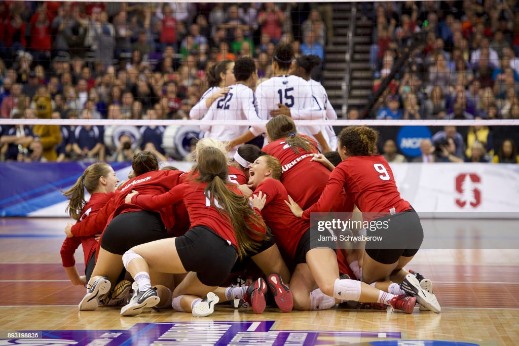 The University of Nebraska celebrates their victory over Penn State University during the Division I Women's Volleyball Semifinals held at Sprint Center on December 14, 2017 in Kansas City, Missouri. Nebraska defeated Penn State 3-2 to advance to the finals.