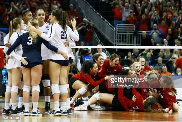The University of Nebraska celebrates their victory over Penn State University during the Division I Women's Volleyball Semifinals held at Sprint...