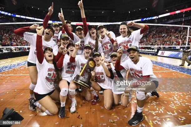 The University of Nebraska celebrates with the national championship trophy during the Division I Women's Volleyball Championship held at Sprint...