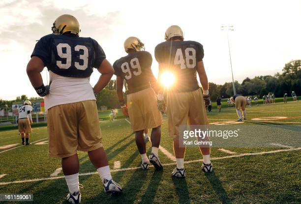 The University of Northern Colorado Bears football team practiced into the night Tueday August 18 2009 in Greeley From left are DT Pasi Fahina DE...