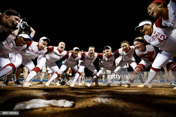 The University of Oklahoma players get in a huddle and celebrate after defeating the University of Florida 54 in Game 2 of the Division I Women's...