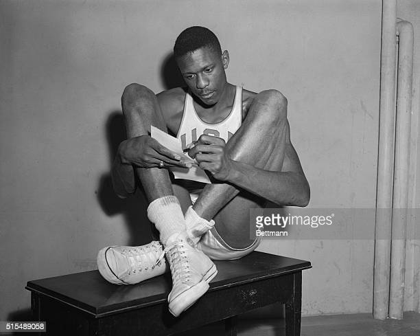 The University of San Francisco Basketball star, two-time All-American Bill Russell sits like a giant grasshopper as he relaxes in his unique way....