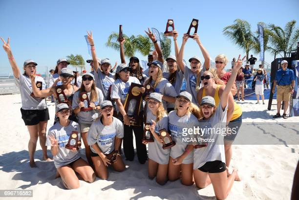 The University of Southern California celebrates after defeating Pepperdine University during the Division I Women's Beach Volleyball Championship...
