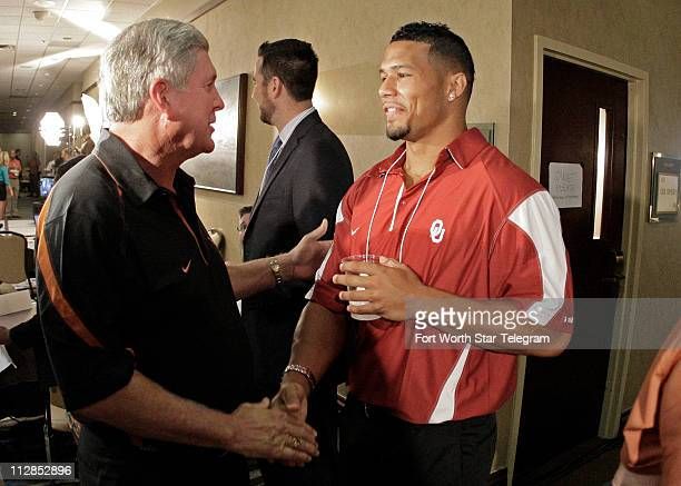 The University of Texas head football coach Mack Brown, left, greets Oklahoma University's Travis Lewis during the last day of the Big 12 college...
