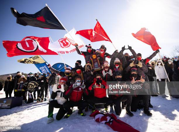 The University of Utah poses with the NCAA Skiing Championship trophy after winning the event on March 13, 2021 in Jackson, New Hampshire.