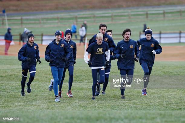 The University of Wisconsin men's team warms up before the race during the Division III Men's and Women's NCAA Photos via Getty Images Cross Country...
