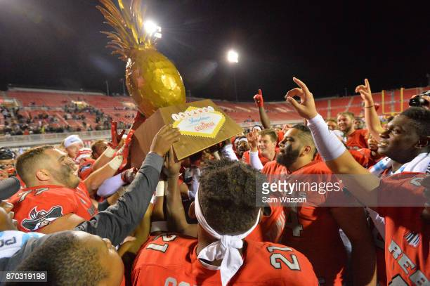 The UNLV Rebels celebrate with the Island Showdown Trophy after winning their game against the Hawaii Warriors at Sam Boyd Stadium on November 4 2017...