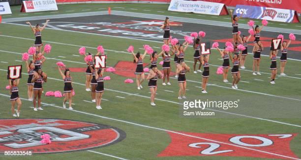 The UNLV Rebels cheerleaders perform during the team's game against the Utah State Aggies at Sam Boyd Stadium on October 21 2017 in Las Vegas Nevada