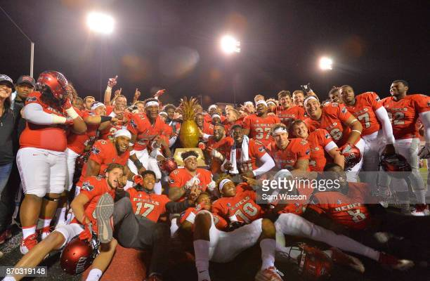 The UNLV Rebels pose for a photo with the Island Showdown Trohpy after winning their game against the Hawaii Warriors at Sam Boyd Stadium on November...