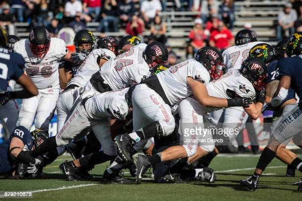 The UNLV Rebels push forward against the Nevada Wolf Pack at Mackay Stadium on November 25 2017 in Reno Nevada