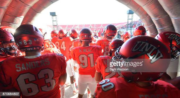 The UNLV Rebels wait to take the field before their game against the Hawaii Warriors at Sam Boyd Stadium on November 4 2017 in Las Vegas Nevada