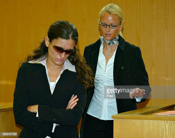 The unnamed woman who former TV presenter Andreas Tuerk is accused of raping is seen wearing sunglasses at the start of the legal process against...