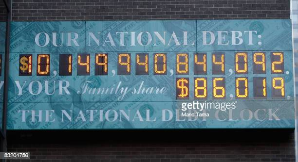 The unofficial National Debt Clock is seen with a makeshift 1 in the dollar sign box marking the federal government's expanding current debt of about...