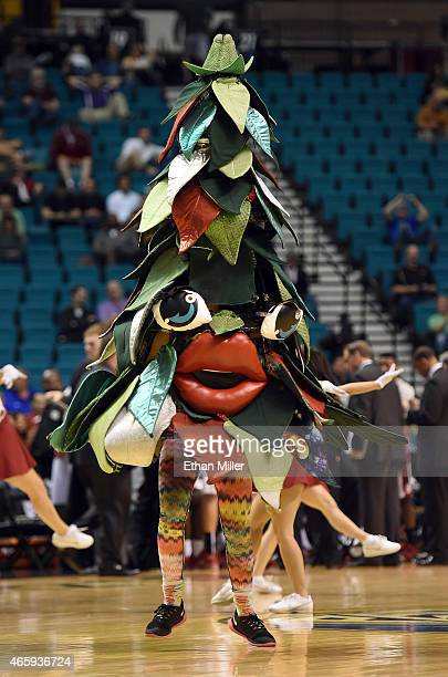 The unofficial tree mascot of the Stanford Cardinal performs during a firstround game of the Pac12 Basketball Tournament against the Washington...