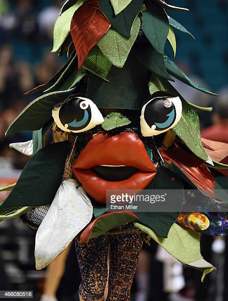 The unofficial tree mascot of the Stanford Cardinal performs during a quarterfinal game of the Pac12 Basketball Tournament against the Utah Utes at...
