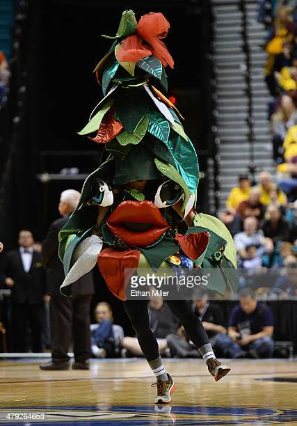 The unofficial tree mascot of the Stanford Cardinal performs during a quarterfinal game of the Pac12 Basketball Tournament against the Arizona State...