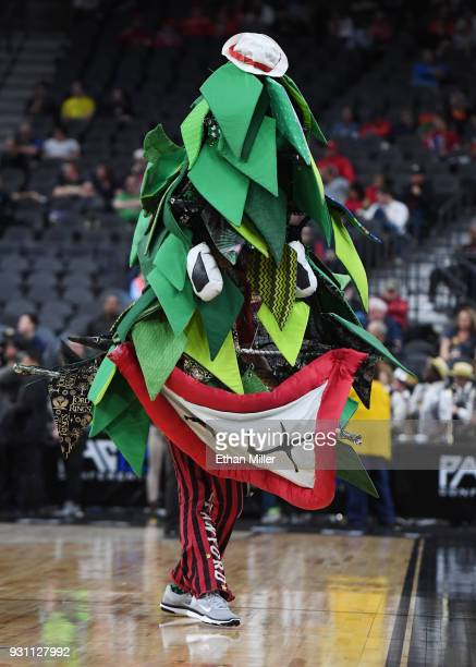 The unoffical tree mascot of the Stanford Cardinal performs during the team's firstround game of the Pac12 basketball tournament against the...