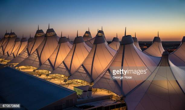 The unusual fabriccovered tent construction of the main terminal designed to be reflective of the nearby snowcapped Rocky Mountains is viewed from...