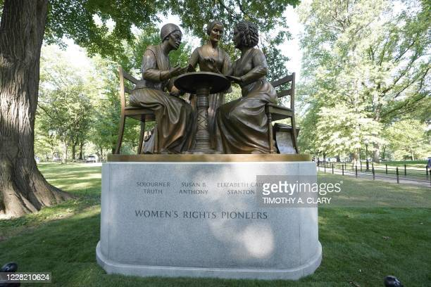 TOPSHOT The unveiling of the statue of women's rights pioneers Susan B Anthony Elizabeth Cady Stanton and Sojourner Truth is seen in Central Park in...