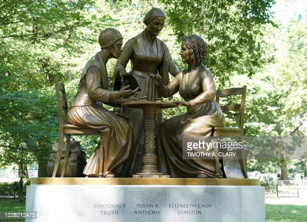 The unveiling of the statue of women's rights pioneers Susan B Anthony Elizabeth Cady Stanton and Sojourner Truth is seen in Central Park in New York...