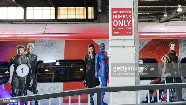 """The unveiling of Virgin trains """"X- Men: Days Of Future Past"""" 11 carriage Pendolino at Euston Station."""