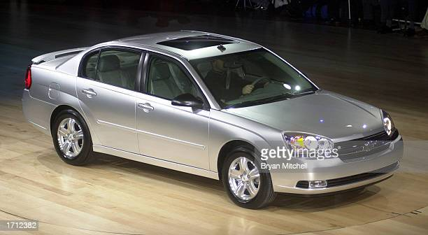The updated Chevrolet Malibu sedan is shown during a news conference at the North America International Auto Show January 7 2003 in Detroit Michigan