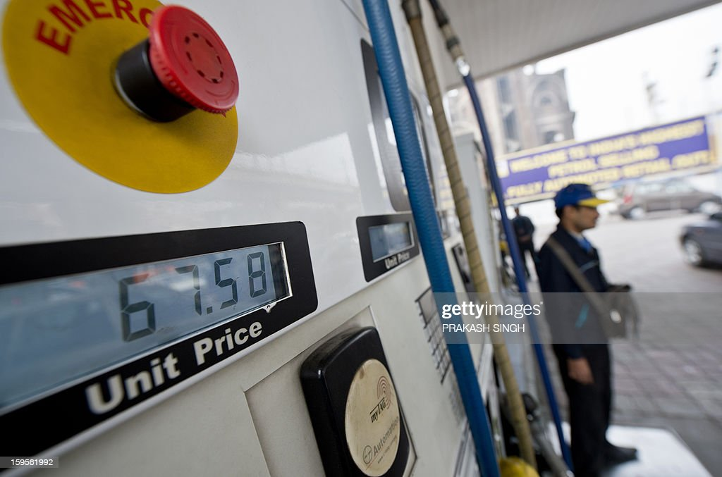 The updated petrol price per litre is seen on a petrol pump display at a fuel station in New Delhi on January 16, 2013. Petrol price was hiked late January 15 night by about 35 paise per litre in line with firming raw material cost. Petrol will cost Rs 67.56 per litre in Delhi with effect from midnight, as the state government withdrew VAT exemption on the fuel. AFP PHOTO/ Prakash SINGH