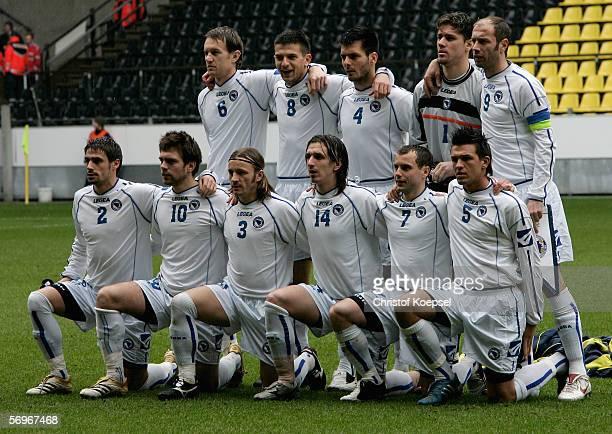 The upper alignment of the team of Bosnia and Herzegovina starts with Sasa Papac Vladan Grujic Emir Spahic goalkeeper Kenan Hasegic and Sergej...