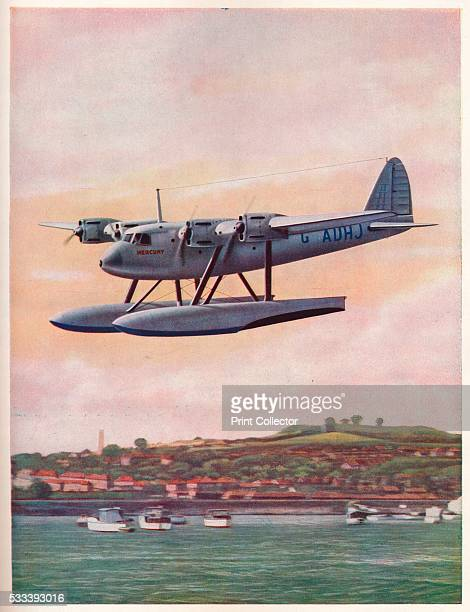 The upper component of the ShortMayo Composite Aircraft 'Mercury' undergoing flight trials at Rochester Kent' from 'Wonders of World Aviation Vol 1'...