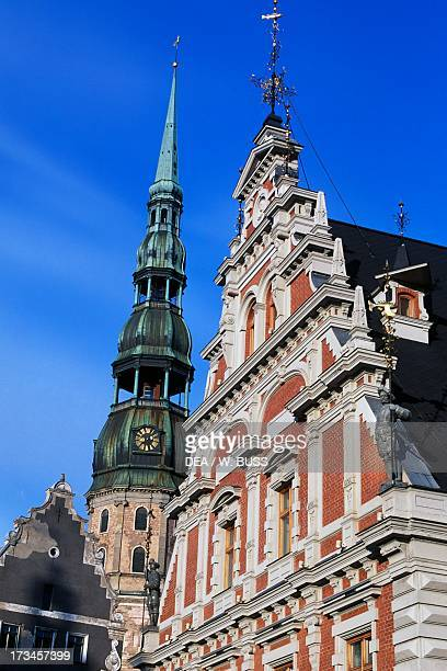 The upper part of the facade House of the Blackheads and Gothic church of St Peter Riga Latvia Riga Latvia