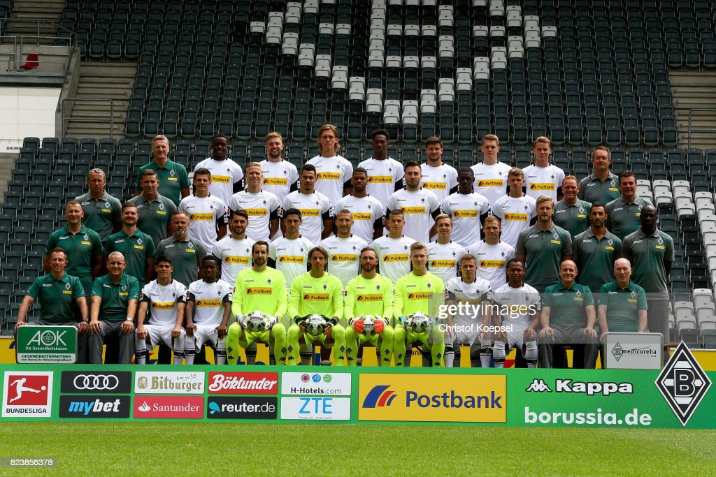 The upper row starts with doctor Stefan Hertl, Denis Zakaria, Christoph kramer, Jannik Vestergaard, Reece Oxford, Toibias Strobl, Matthias Ginter, Nicol Elvedi, medicin and prevention doctor Andreas Schlumberger. The middle row (L-R) starts with assistant coach Frank Geideck, goalkeeper coach Uwe Kamps, Jonas Hof,amm, Oscar Wendt, Timothee Kolodziejczak, Kwame Yeboah, Josip Drmic, Mamadou Doucoure, Michael Cuisane, assistant coach Dirk Bremser, head coach Dieter hecking. The front row (L-R) starts with maseur Adam Szordykowski, kit manager Christian Rieger, Julio Villalba, Ibrahima Traore, Christofer Heimeroth, Yann Sommer, Tobias Sippel, Moritz Nicolas, Thorgan Hazard, Raffael, kit manager Marcus Breuer and team manager Rolf Huelswitt of Borussia Moenchengladbach poses during the team presentation at Borussia Park on July 28, 2017 in Moenchengladbach, Germany.