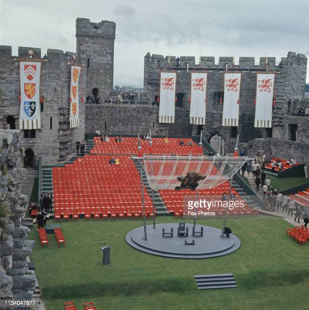 The Upper Ward of Caernarfon Castle prepared for the investiture of Prince Charles as Prince of Wales, 1st July 1969. The walls behind the spectator...