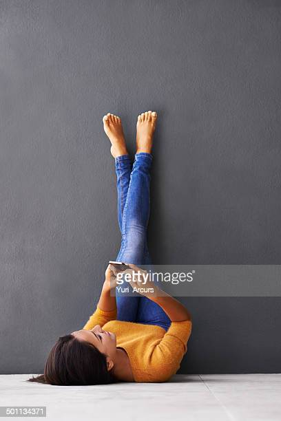 the upside-down approach to texting - feet up stock pictures, royalty-free photos & images