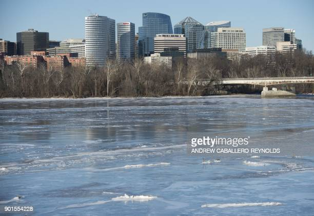 The urban neighborhood of Rosslyn is seen across a frozen Potomac river in Washington DC on January 5 2018 The National Weather Service said that...