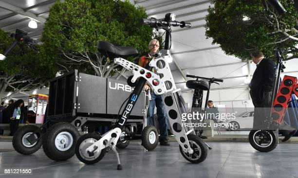 The URBE electric folding bicycle is on display inside the Technology Pavilion at the 2017 LA Auto Show in November 28 2017 in Los Angeles California...