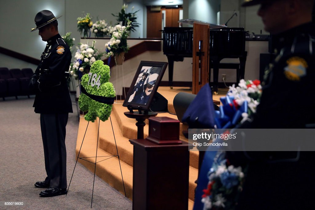 The urn box containing the remains of Virginia State Police Trooper-Pilot Berke M.M. Bates is guarded by fellow troopers during his funeral at Saint Paul's Baptist Church August 18, 2017 in Richmond, Virginia. Bates and Lieutenant Pilot Jay Cullen were killed when their Bell 407 helicopter crashed into a wooded area while they were monitoring the civil unrest during the white supremacy 'Unite the Right' rally August 12 in Charlottesville, VA.