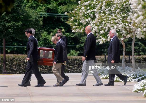 The urn containing the ashes of former White House press secretary Tony Snow is carried out of the National Shrine of the Immaculate Conception...