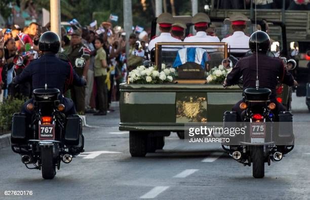 The urn with the ashes of Cuban leader Fidel Castro is taken from Revolution Square in Santiago Cuba on December 4 2016 to the cemetery The ashes of...