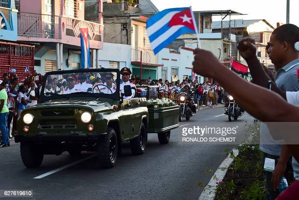 TOPSHOT The urn with the ashes of Cuban leader Fidel Castro leaves Revolution Square in Santiago Cuba on December 4 2016 on its way to the cemetery...