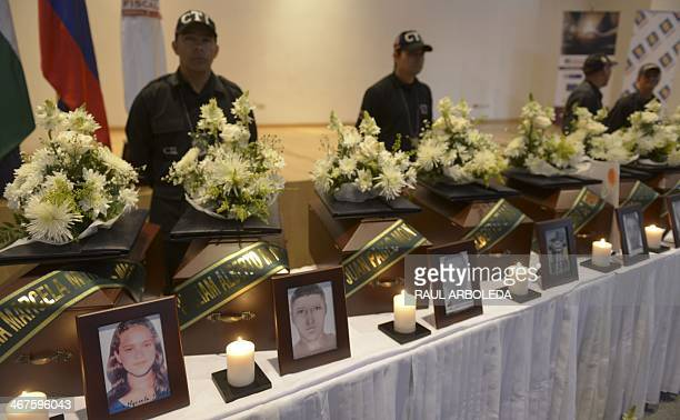 The urns containing the remains of missing persons in the Colombian civil war are seen in a ceremony in Medellin Antioquia department Colombia on...