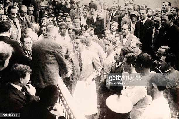 The Uruguay team led by their captain Jose Nasazzi are greeted by FIFA President Jules Rimet during the opening ceremony of the 1930 World Cup Finals...