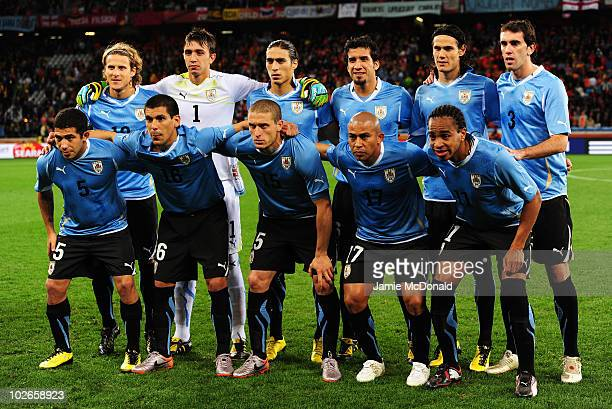 The Uruguay team line up ahead of the 2010 FIFA World Cup South Africa Semi Final match between Uruguay and the Netherlands at Green Point Stadium on...