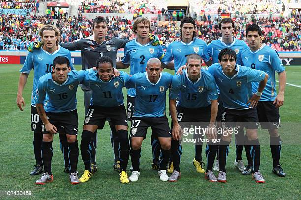 The Uruguay team line up for a group photo prior to the 2010 FIFA World Cup South Africa Round of Sixteen match between Uruguay and South Korea at...