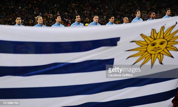 The Uruguay team lines up for the national anthems prior to the 2010 FIFA World Cup South Africa Group A match between Uruguay and France at Green...