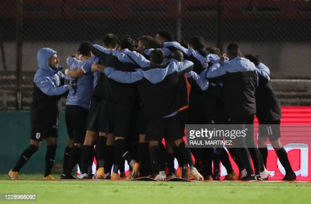 The Uruguayan team celebrates after striker Maximiliano Gomez scored against Chile during their 2022 FIFA World Cup South American qualifier football...