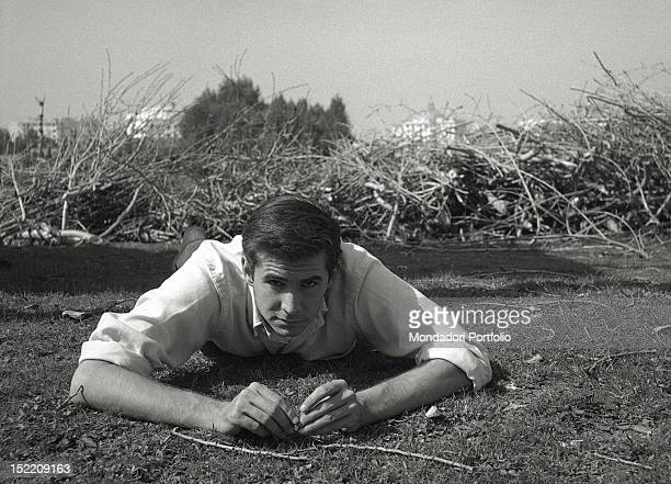 The US actor Anthony Perkins best known for playing Norman Bates the serial killer of the film 'Psycho' directed by Alfred Hitchcock is lying down on...